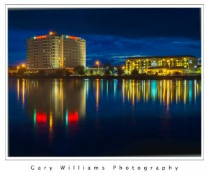 Photograph of the Embassy Suites Hotel and reflection in Laguna Grande Lake in Seaside California