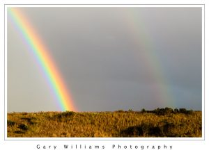 Photograph of a double rainbow at Moss Landing, California