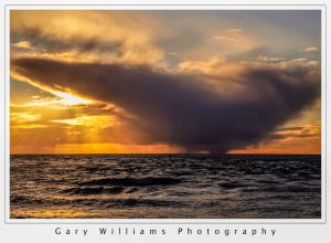 Photograph of a dramatic clouds at Moss Landing Beach, California
