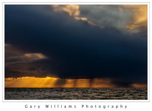 Photograph of a dramatic clouds at Moss Landing Beach, California