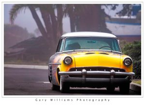 Photograph of a yellow car at Moss Landing, California