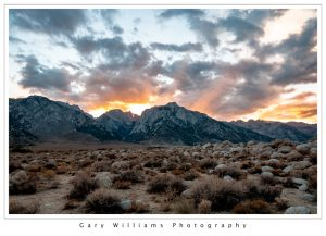 Photograph of clouds and sunrise over mountains near Lone Pine, California